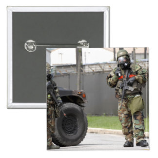 Soldiers stand guard at an intersection pinback button