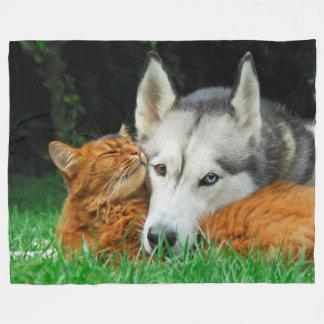 Somali cat and Siberian Husky cute friends huddle Fleece Blanket