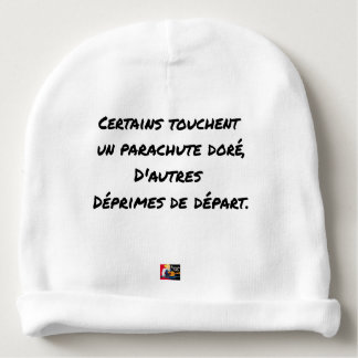 SOME TOUCH A GILDED PARACHUTE, OTHERS BABY BEANIE