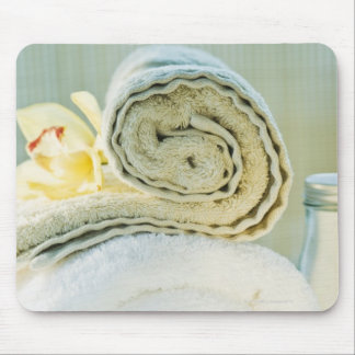 Spa towels and tropical flower mouse pad