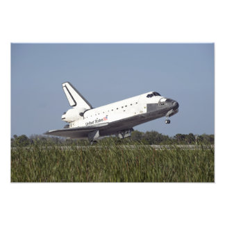 Space shuttle Atlantis touches down on Runway 3 Photograph