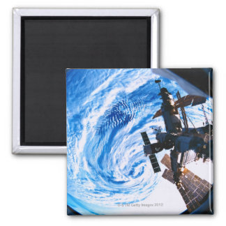 Space Station Orbiting Earth 9 Square Magnet
