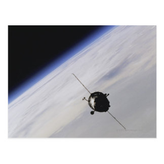 Spacecraft in outer space postcard