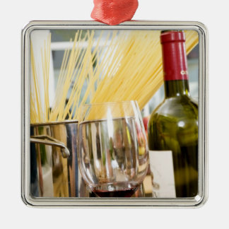 Spaghetti in pan with wine bottle and glasses metal ornament