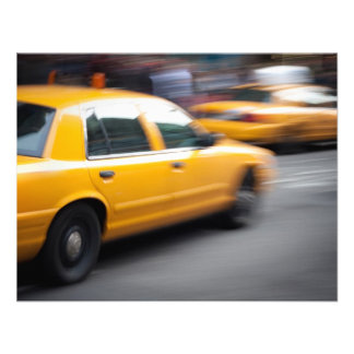 Speeding Yellow NY City Taxi Cab with Motion Blur Invites