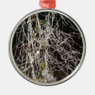 Spider webs with dew drops metal ornament