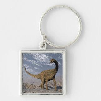 Spinophorosaurus dinosaur walking in the desert key ring