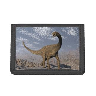 Spinophorosaurus dinosaur walking in the desert tri-fold wallets
