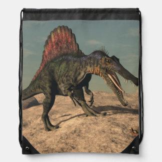 Spinosaurus dinosaur hunting a snake drawstring bag