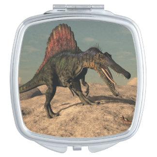 Spinosaurus dinosaur hunting a snake mirrors for makeup