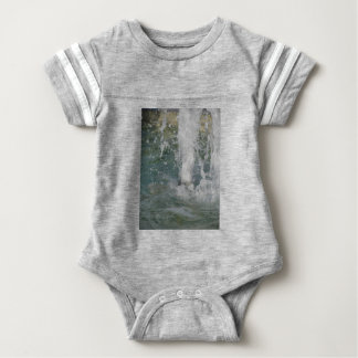 Splashes of fountain water in a sunny day baby bodysuit