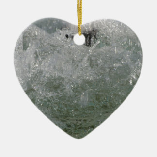Splashes of fountain water in a sunny day ceramic heart decoration