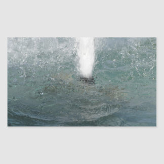 Splashes of fountain water in a sunny day rectangular sticker