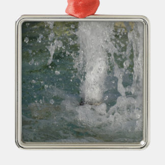 Splashes of fountain water in a sunny day Silver-Colored square decoration