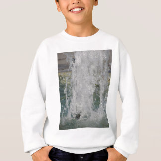 Splashes of fountain water in a sunny day sweatshirt