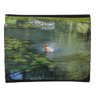 Splashing duck in a pond leather wallets