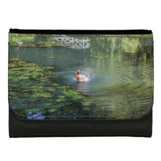 Splashing duck in a pond wallet
