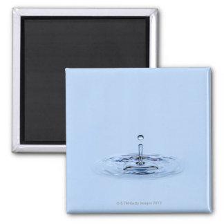 Splashing waterdrop (droplet) falling into water square magnet