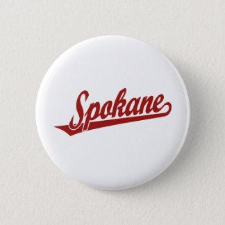 Spokane script logo in red 6 cm round badge