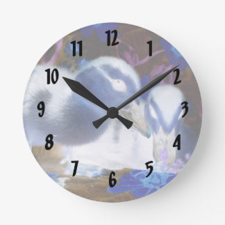 Spooky blue and white baby ducks round clock