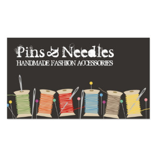 Spools of thread pins, needles sewing biz cards business cards