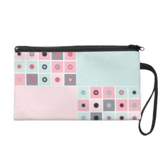 Spotted geometric pattern wristlet purses