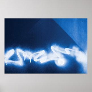 Sprayed graffiti on blue metal posters