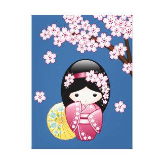 Spring Kokeshi Doll - Cute Japanese Geisha on Blue Canvas Print