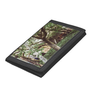 Spring Orchard With Ladder Against Tree Tri-fold Wallets