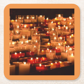 SQUARE PAPER COASTER WITH LIT CANDLES.