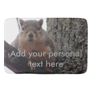 Squirrel looking at your bath mat