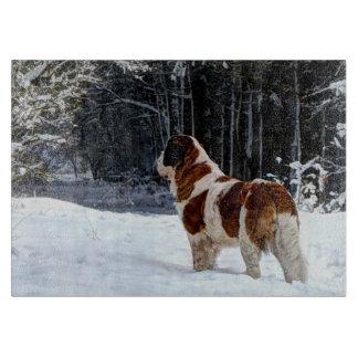 St Bernard dog in the snow Cutting Boards