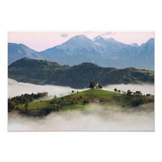 St. Thomas church with mountains in Slovenia photo