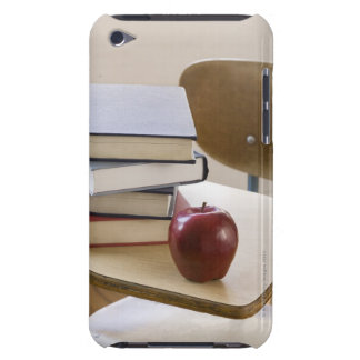 Stack of books, apple, and school desk barely there iPod case
