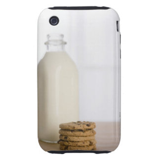 Stack of chocolate chip cookies milk in a glass tough iPhone 3 cover