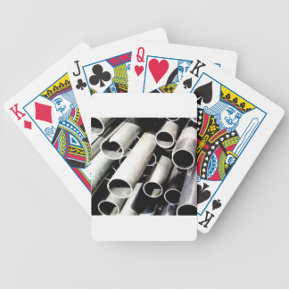 stack of metal tubes bicycle playing cards