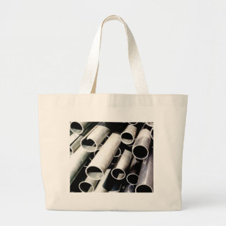 stack of metal tubes large tote bag