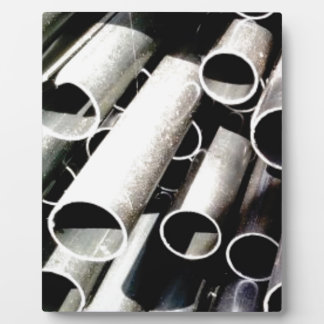 stack of metal tubes plaque