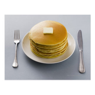 Stack of pancakes with butter on a plate postcard