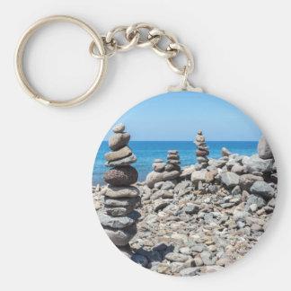 Stacked beach stones at blue sea key ring
