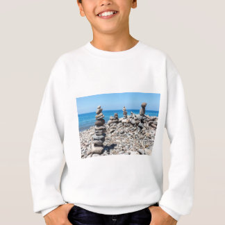 Stacked beach stones at blue sea sweatshirt