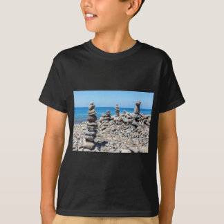 Stacked beach stones at blue sea T-Shirt