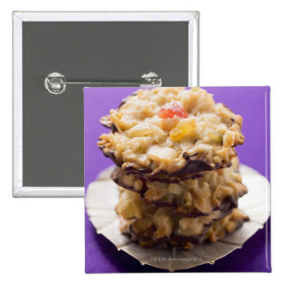 Stacked florentines on plate, close-up 15 cm square badge