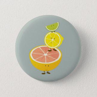 Stacked smiling citrus fruit 6 cm round badge