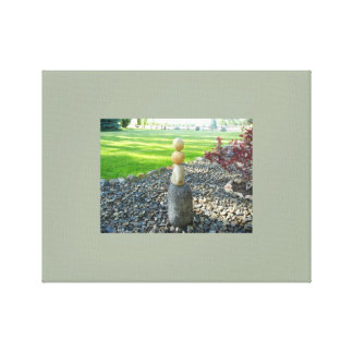 Stacking Rocks in the Yard Canvas Print