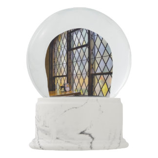 Stained glass brewery with silver angels snow globe
