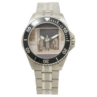 Stainless steel watch and vintage blacksmith photo