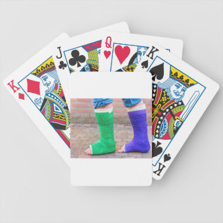 Standing child with two colorful gypsum legs bicycle playing cards