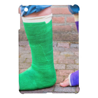 Standing child with two colorful gypsum legs iPad mini cases