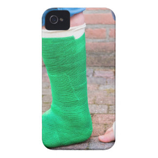 Standing child with two colorful gypsum legs iPhone 4 cases